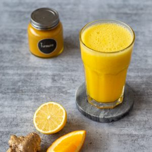A citrus, ginger and turmeric juice made in the Thermomix.