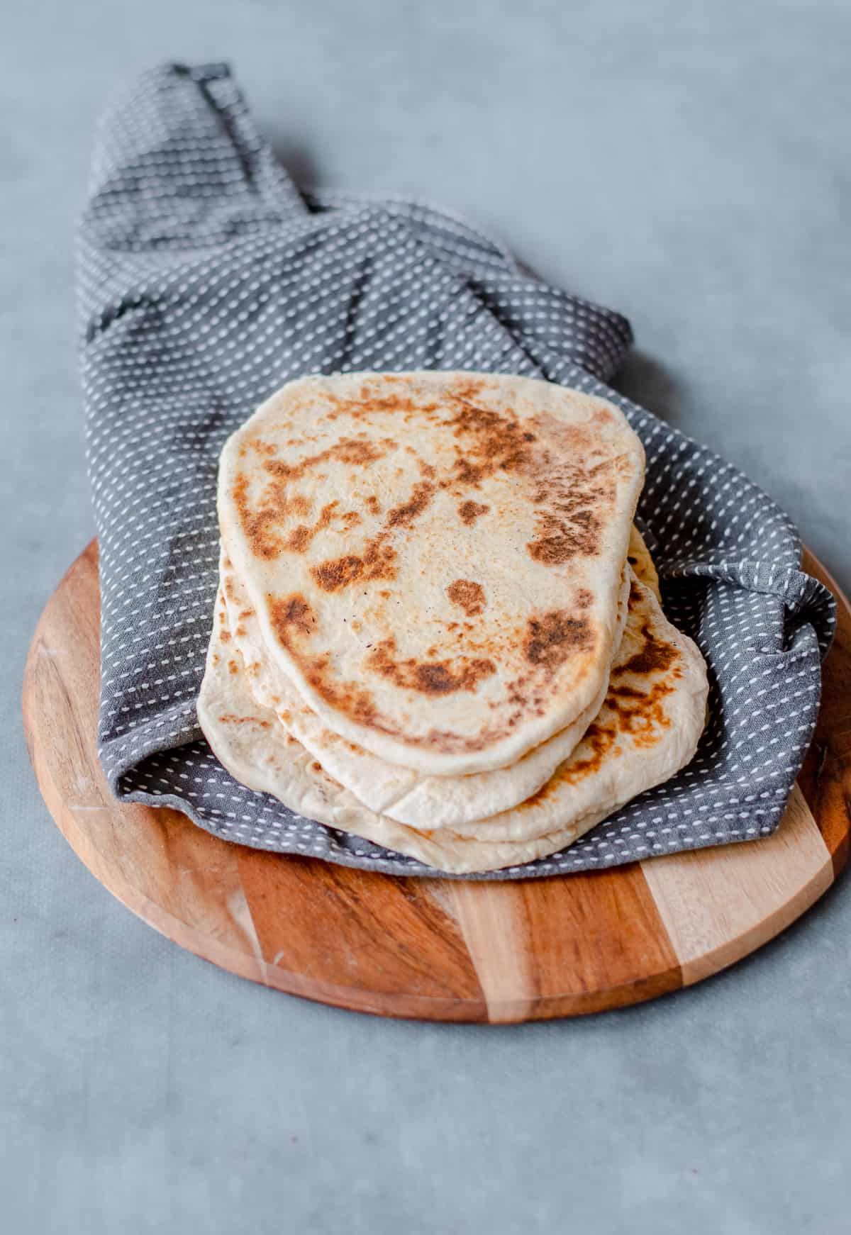 Homemade Naan Bread on a tea towel
