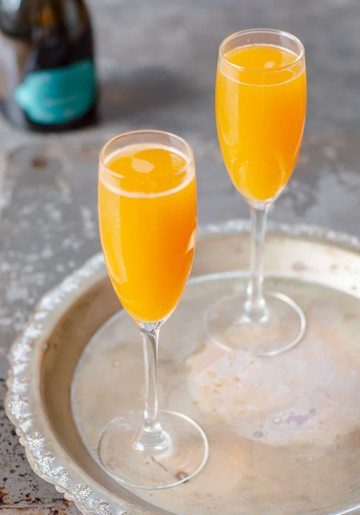Peach Bellinis on a silver tray