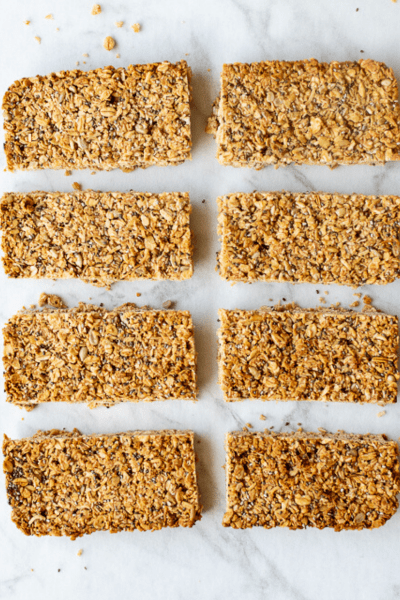 Homemade Granola bars cut into 8 slices on white background