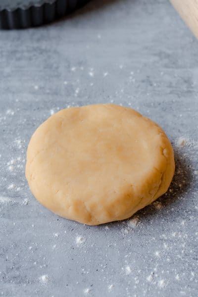 Raw Sweet Shortcrust Pastry with rolling pin and baking tray