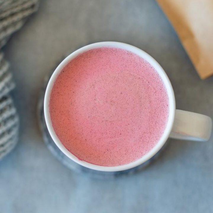 Overhead image of beetroot latte in white mug