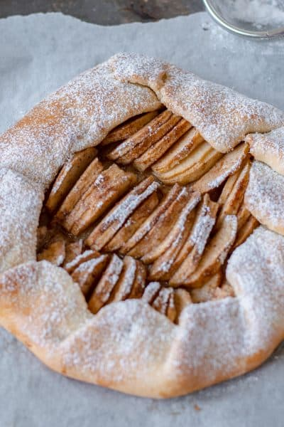 Apple Galette on baking paper waiting to be sliced