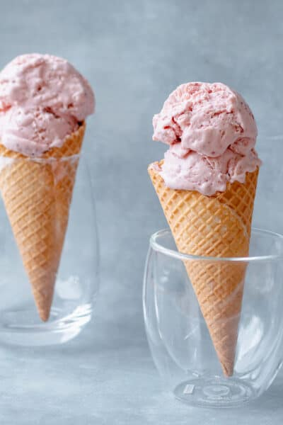 Two Homemade Strawberry Ice Creams in waffle cones
