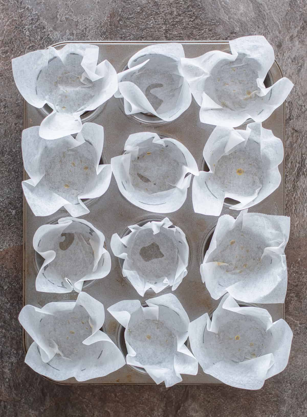 12 Homemade muffins cases in muffin tin