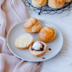Lemonade scones on a blue plate with cream and jam