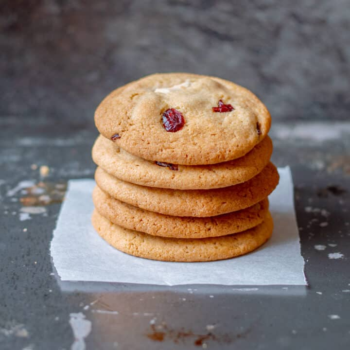 5 white chocolate and cranberry cookies in a stack