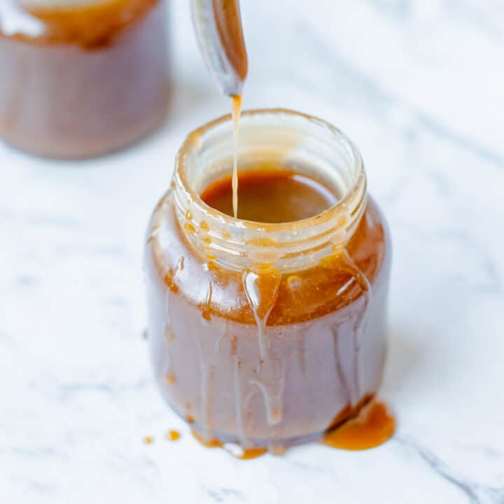 Caramel sauce in a glass jar