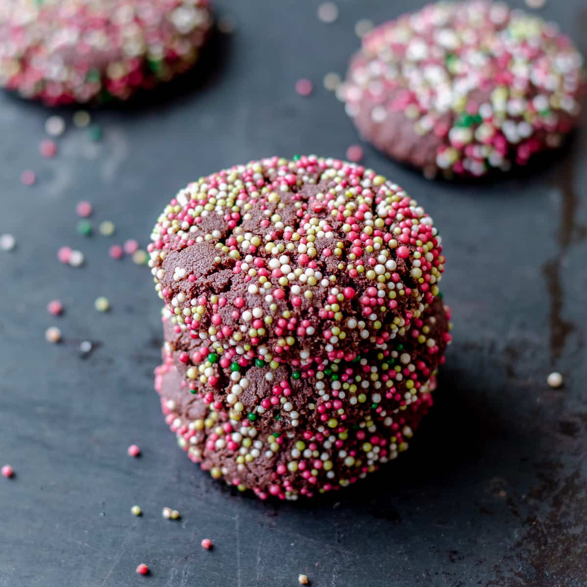 Christmas chocolate cookes covered in red, white and green spinkles