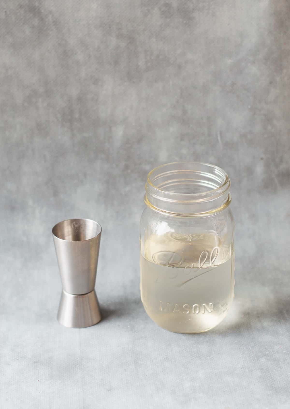 sugar syrup in glass jar with spirit measurer