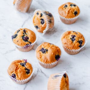 blueberry muffins on white background