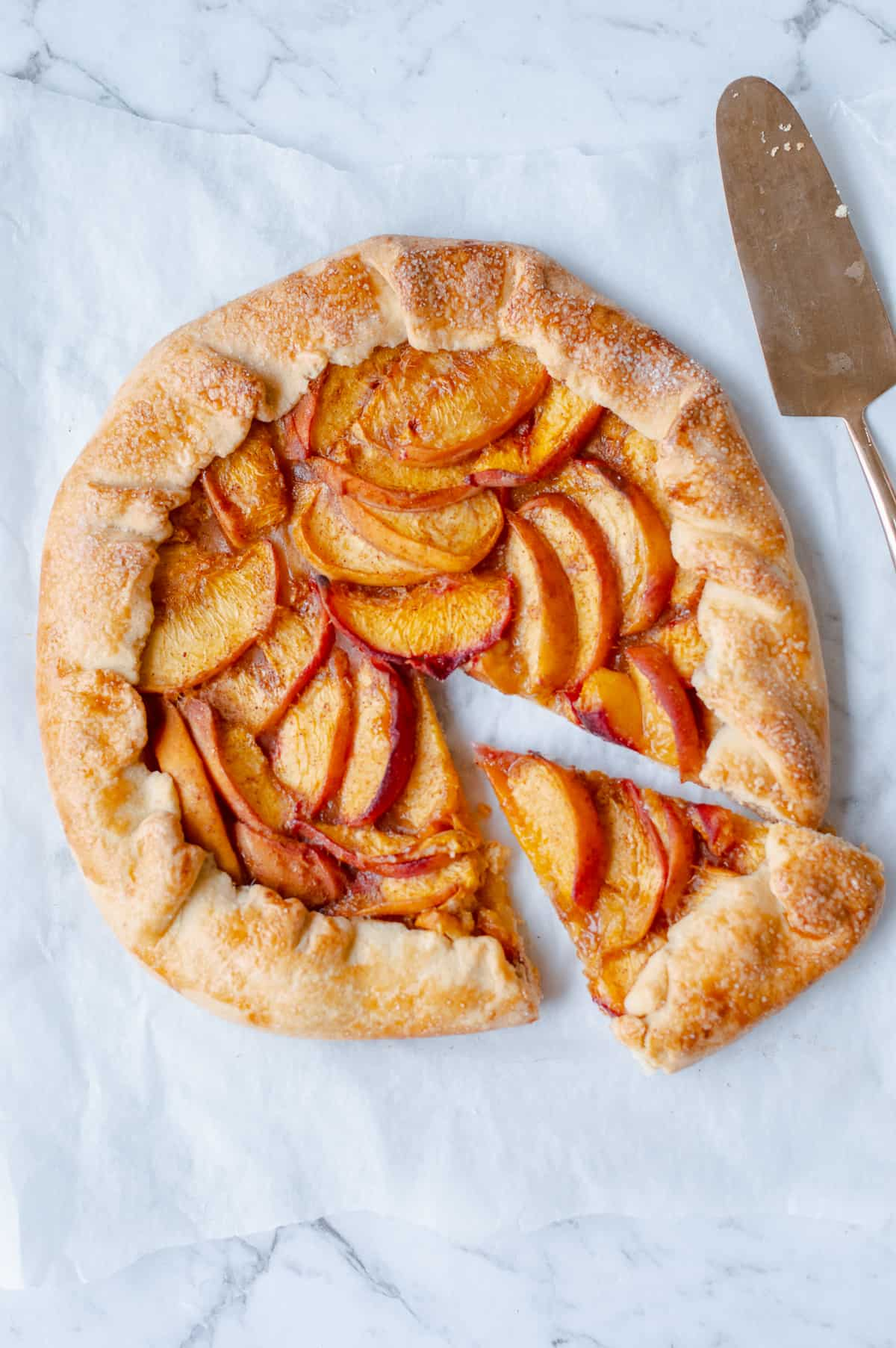 peach galette sliced with a tart slice