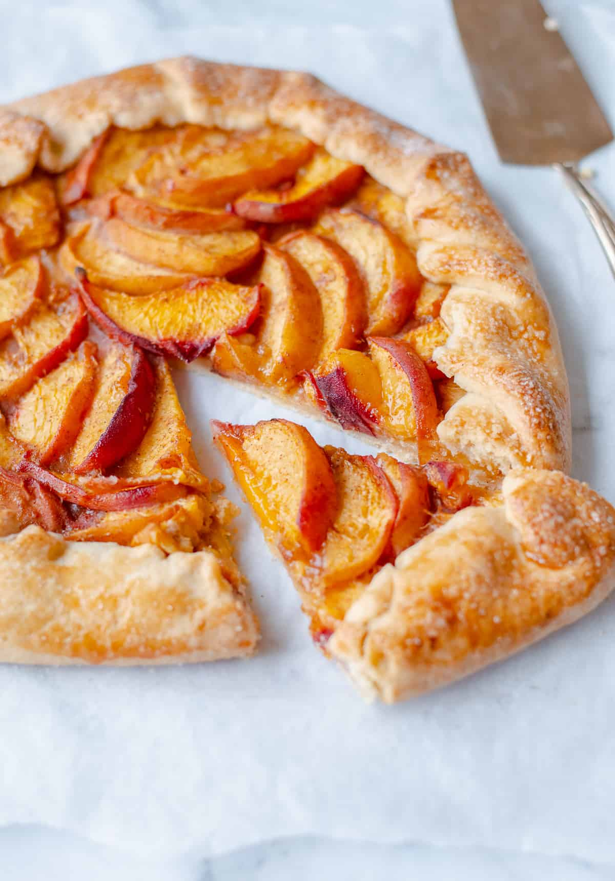 peach galette sliced with tart slice