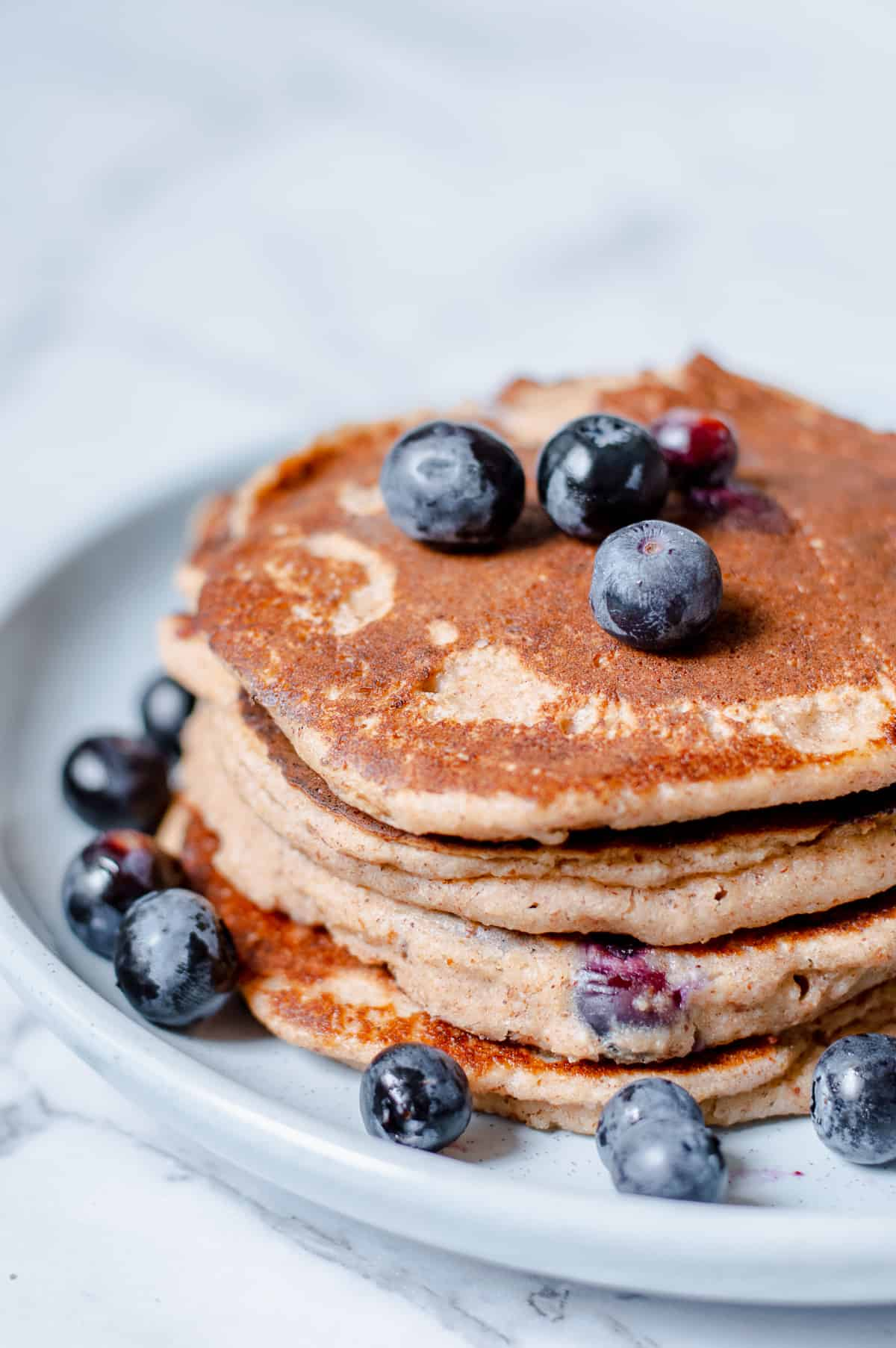 Pancakes with Blueberries on blue plate