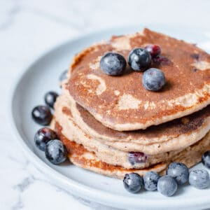 blueberry pancakes on blue plate