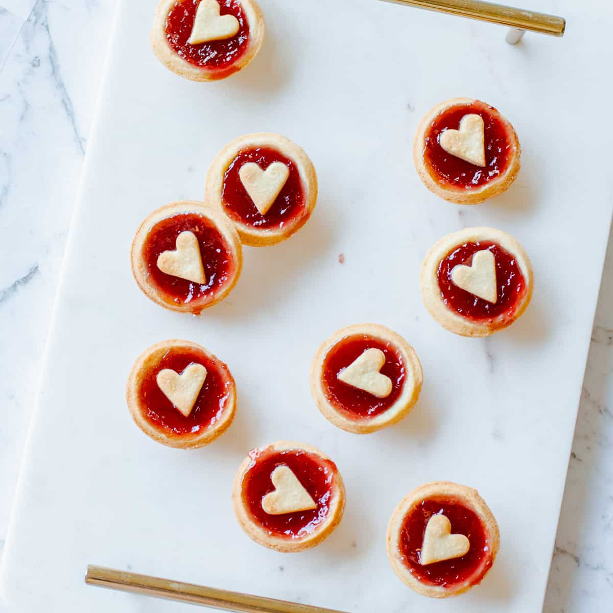 jam tarts with hearts on top