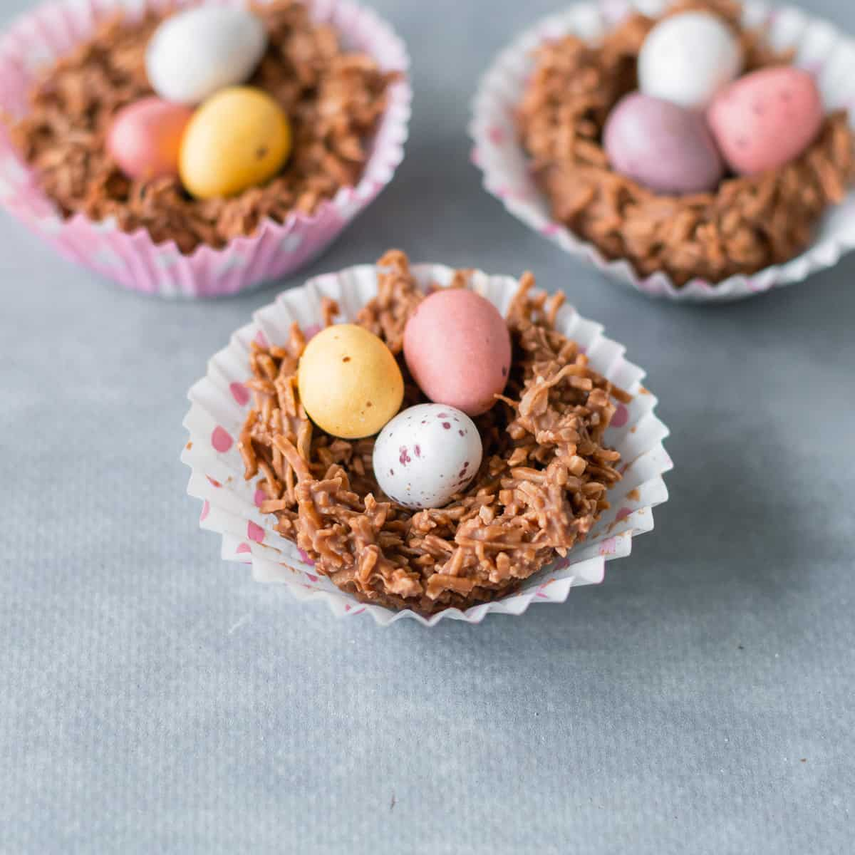 easter egg nests with 3 small easter eggs in each one