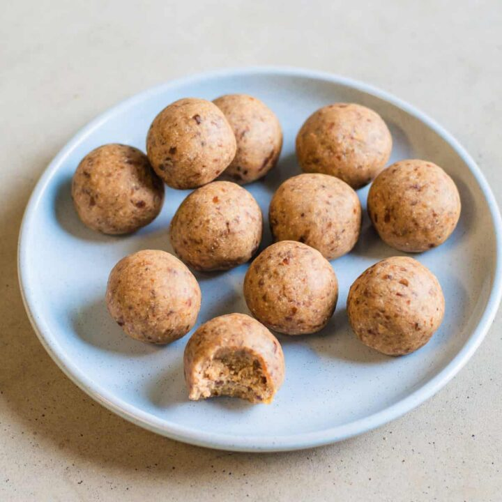 Chai protein balls on a blue plate.