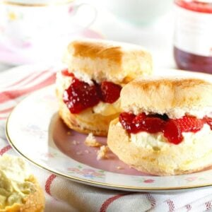 Scones with jam and cream on a plate.
