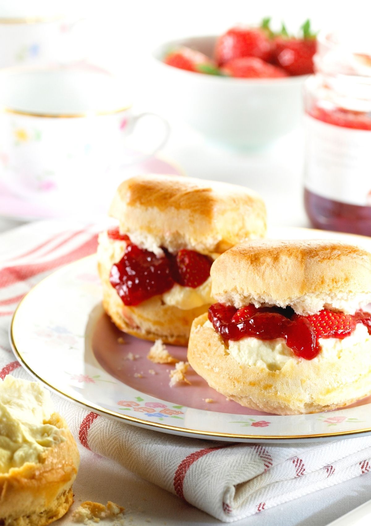 Homemade scones with cream and strawberry jam.